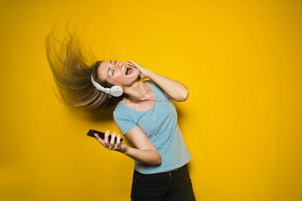 photography-of-woman-listening-to-music